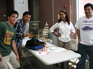 students gathered around a project created in the C3P program