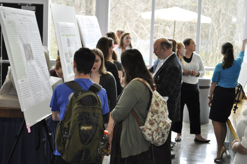 Students discuss posters at EURECA
