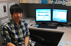 Kanel Nang sitting at his desk at USLI