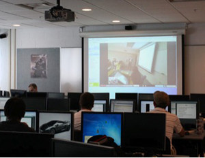 students listening to a professor on a screen through the Video Learning Network