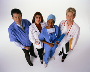 one man and three women in medical garb