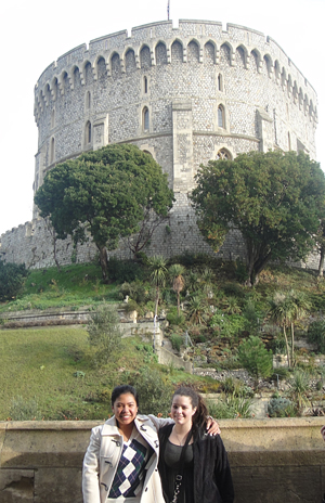 two students standing with Windosr Castle behind them