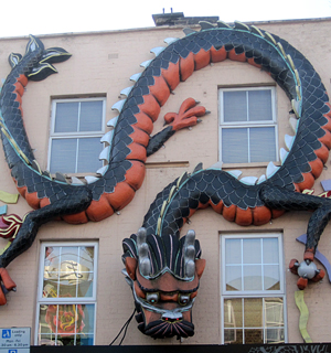 dragon sculpture on a wall in Chinatown