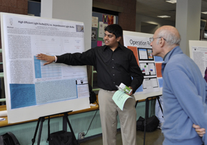image of student with research poster
