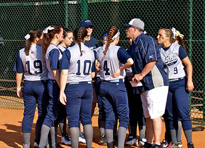 softball team in a huddle