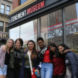 students in front of Tenement Museum sign