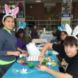 Students decorating eggs