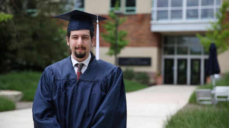 Joseph Longobardi in his cap and gown at commencement