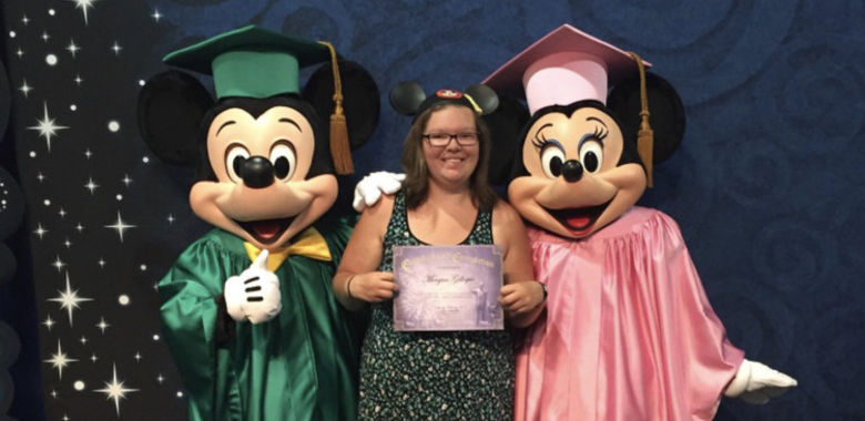 Morgan Gillespie standing between Mickey Mouse and Minnie Mouse
