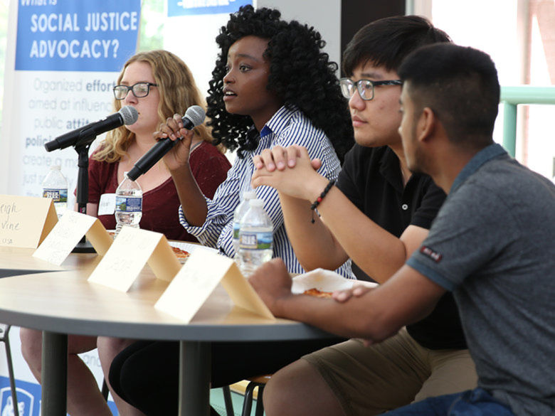 Students speaking on a panel