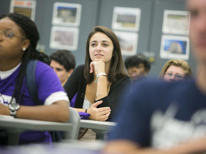student in class listening to professor