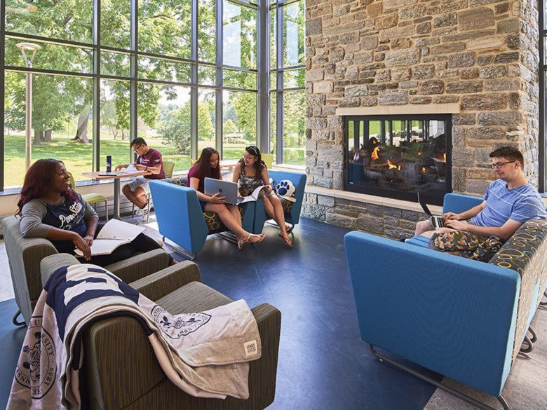 Students sitting by the fire in the Fireside Lounge