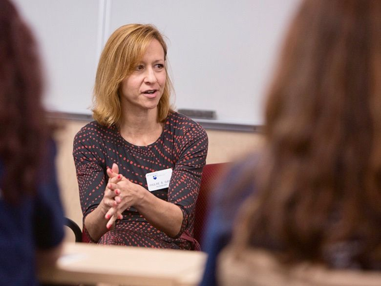 Female faculty member advising students