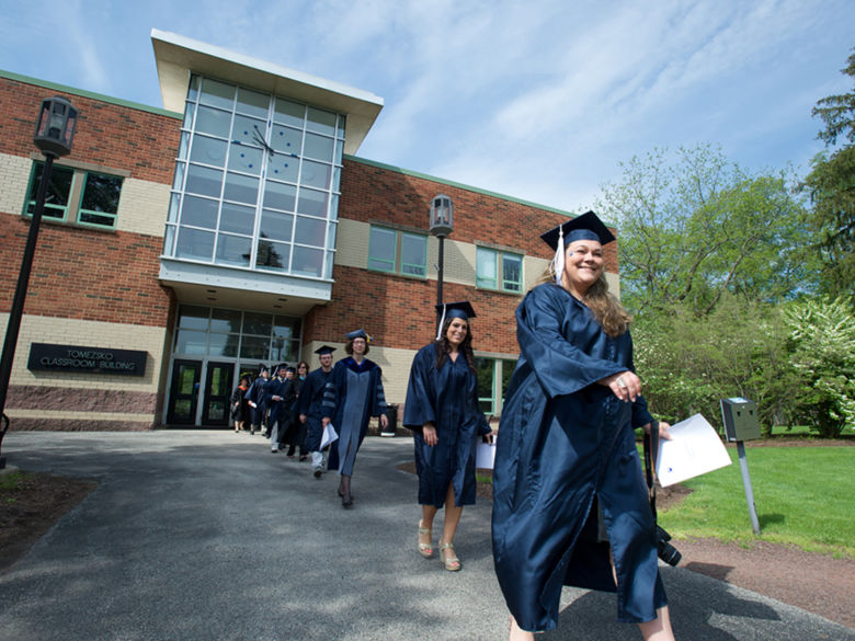 Graduates walking through campus