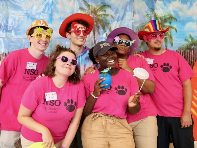 Students posing for photo at beach bash event