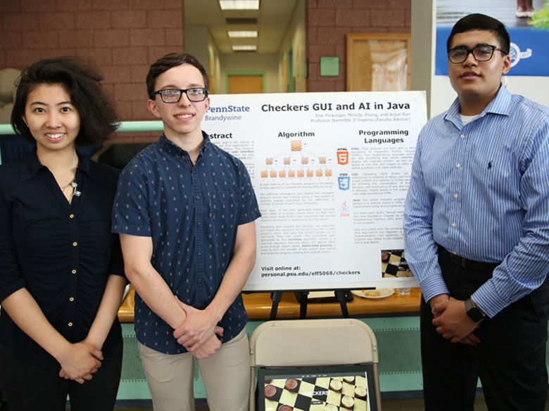 3 students with their research project
