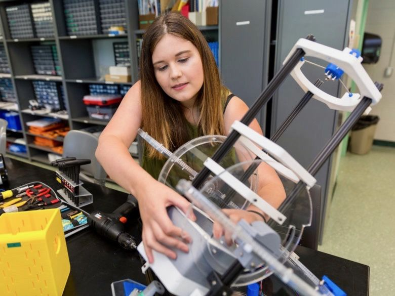 Female engineering student working in lab