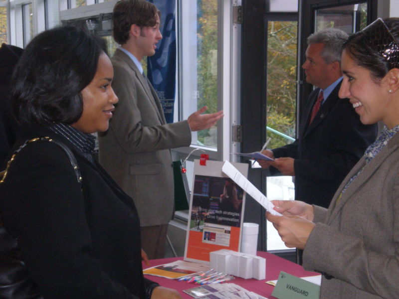 Student speaking with an employer at the career fair