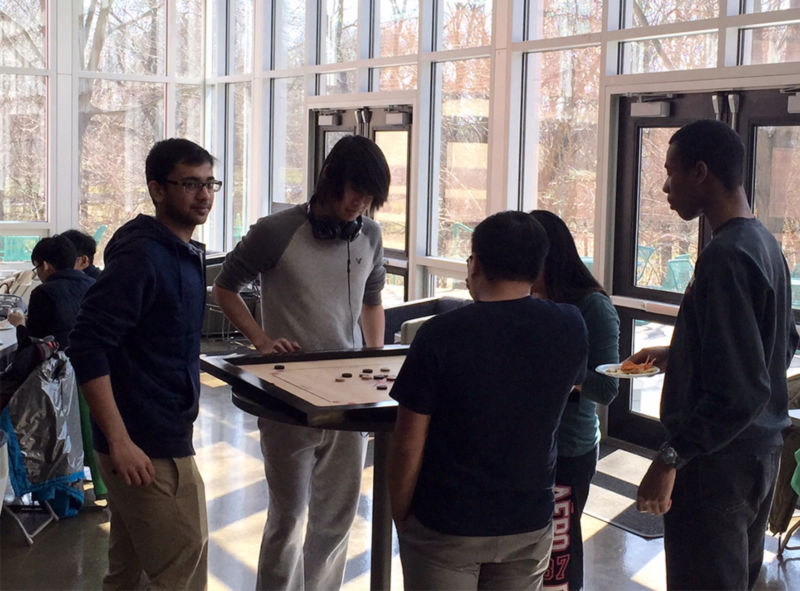 At the March Board Game Break, participants learned the Indian game of Carrom.