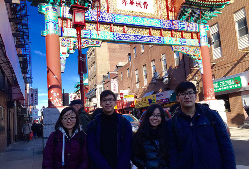 Students at the gate to Philadelphia's Chinatown