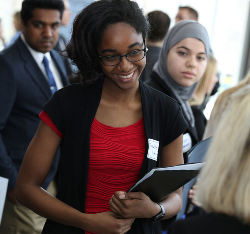 student talking to employer at job fair