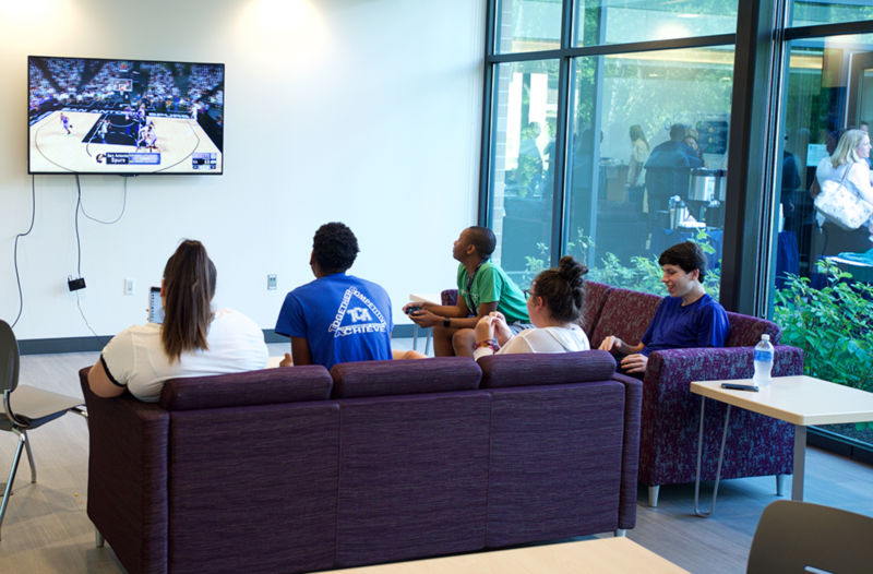 students watching TV in the lounge