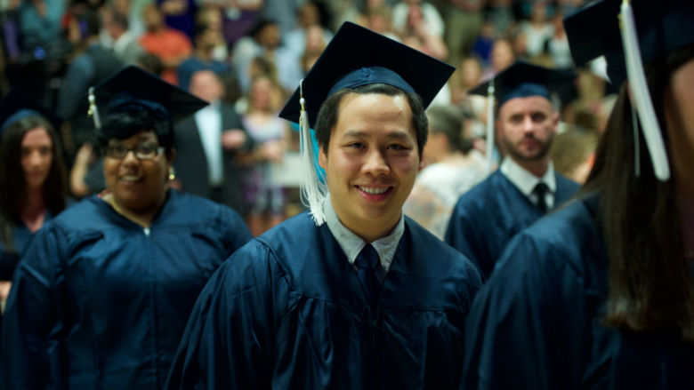 Graduate dressed in full academic reg