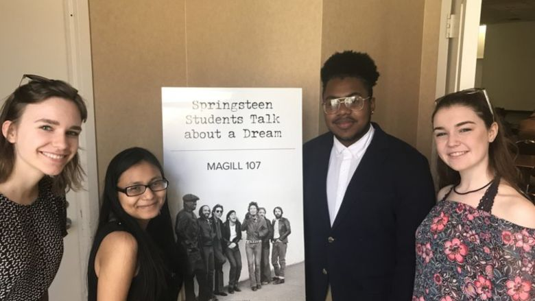 Students with poster at Springsteen conference
